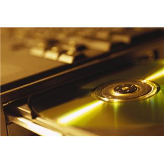 DVD being interted into a laptop