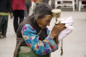 26a. Elderly Tibetan Woman with Prayer Wheel and Recitation Beads, Lhasa Barkhor, Tibet, 2006, Luca Galuzzi, www.galuzzi.it.