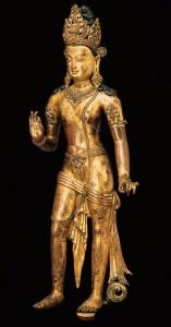 3. Bodhisattva Avalokiteshvara, Nepal, Transitional period, late 10th–early 11th century; gilt copper alloy with inlays of semiprecious stones; 26 3/4 x 11 1/2 x 5 1/4 in.; Asia Society, New York, Mr. and Mrs. John D. Rockefeller 3rd Collection, 1979.47, photo: Susumu Wakisaka, Idemitsu Museum of Arts, Tokyo.