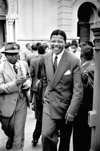 A young Nelson Mandela leaves Pretoria Courthouse following the dismissal of the state's case against him in the so-called Treason Trial.
