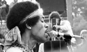 Jimi Hendrix performing at Woodstock Festival