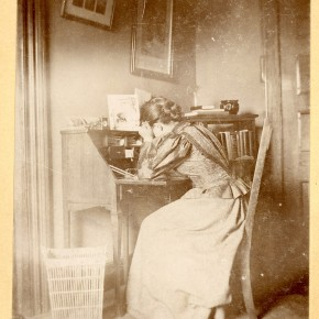 Student at desk in dorm, n.d.