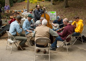 Musicians play together in a jam circle at the festival. Photo by Lonnie Webster for the High Country Press