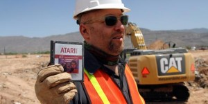 Figure 2: A member of the team holding the Atari 2600 game 'E.T. The Extra-Terrestrial'