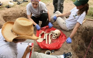 Dr. Lori Baker and her team cataloging a set of bones uncovered at the mass grave site in Falfurrias, Texas.