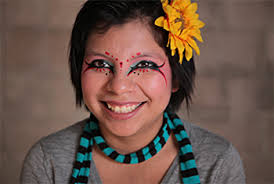 Inocente expresses herself through her art not only on a canvas, but on her face as well