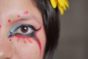 Picture showing the colorful and creative designs Inocente uses in her make-up.