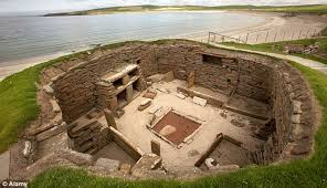 Excavation of a Skara Brae home, complete with artifacts and features such as furniture and drains.