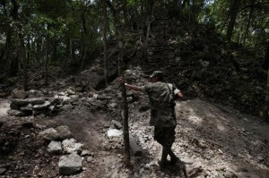 Guatemalan soldier patrolling the border surrounding the Mayan city  Xultun