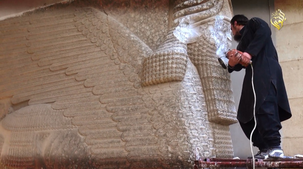 ISIS militant destroying a 3000 year old Assyrian Winged Bull
