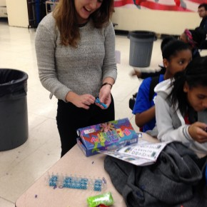 7th grade students taught their mentor Sophia how to make a rubber band bracelet