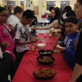 Scholars and mentors lined up to decorate cookies