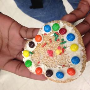 Ravain proudly displays his cookie