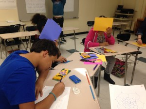 The eighth graders work on their drawings.