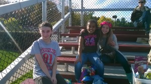 VAST scholars Chiara, Mya, and Gianna have fun in the stands before the game!