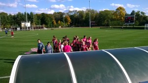 VAST Scholars huddled with the Vassar Women's Soccer Team before the game!